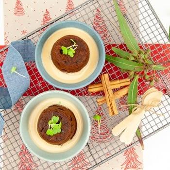 Individual christmas puddings with brandy anglaise