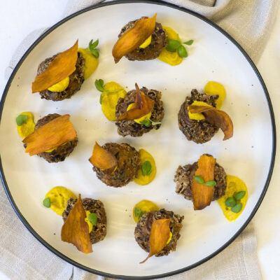 Kale & onion pakora, turmeric & citrus hommus, sweet potato crisp